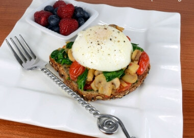 Poached Egg on Toast with Sautéed Mushrooms, Tomatoes, and Spinach