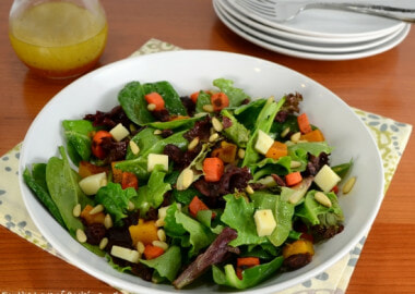 Roasted Carrot and Butternut Squash Salad with Mixed Greens, Extra Sharp Cheddar, and Pine Nuts