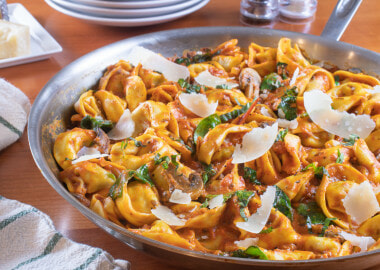 Italian Sausage Tortellini Skillet with Mushrooms and Spinach in a Creamy Tomato Sauce