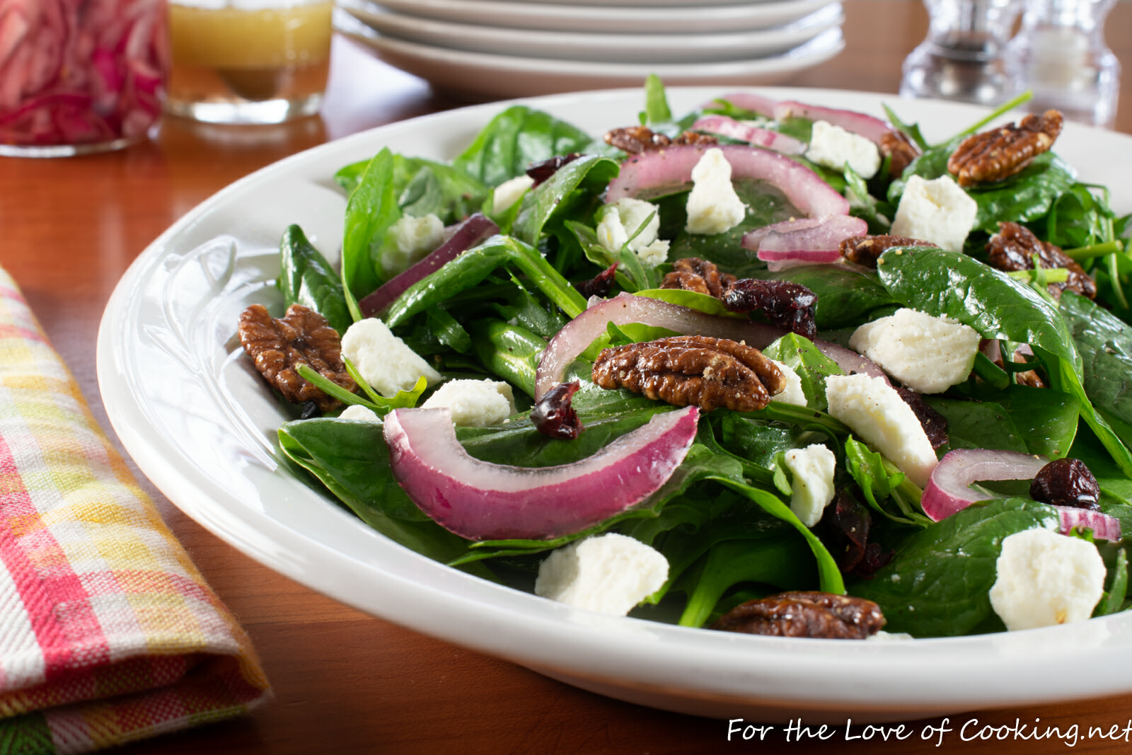 Spinach & Arugula Salad with Marinated Onion, Feta, Cranberry, and Candied Pecans